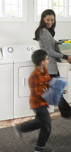Image of mother and child in laundry room